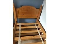 Pine single bed with underneath pull out spare bed