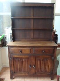 VINTAGE OAK DRESSER - TWO DRAWERS & DOUBLE CUPBOARD BASE WITH SHAPED PLATE RACK TOP - 107 CM. WIDE
