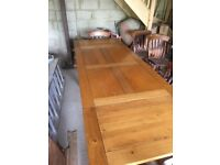 Dining table with extending ends