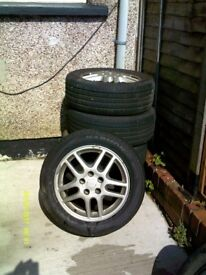 5 Alloy wheels for Vauxhall Vectra. All with good tyres and a set of locking wheel nuts.