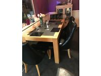 Black slate dining table with 4matching chairs very good condition