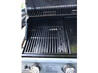 3 burner gas barbecue with nearly full bottle