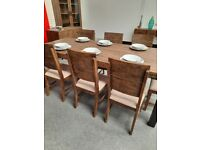 Table and 8 chair's reclaimed wood