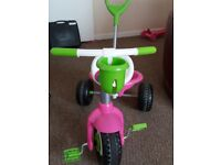 Toddlers tricycle. Plastic. With push around handle (which can be removed).