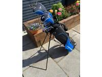 Set of Dunlop golf clubs and bag