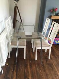 Glass table and chairs for sale