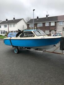 16 ft Taylor fishing boat needs TLC no engine on trailer