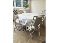White round table and chairs set