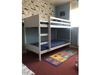 New bunk bed with 2 new mattresses and 2 pair of sheets