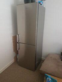 Kenwood Fridge Freezer 1 year old. Availible for July7th onwards. 182 cm H 58cm W 66cm D