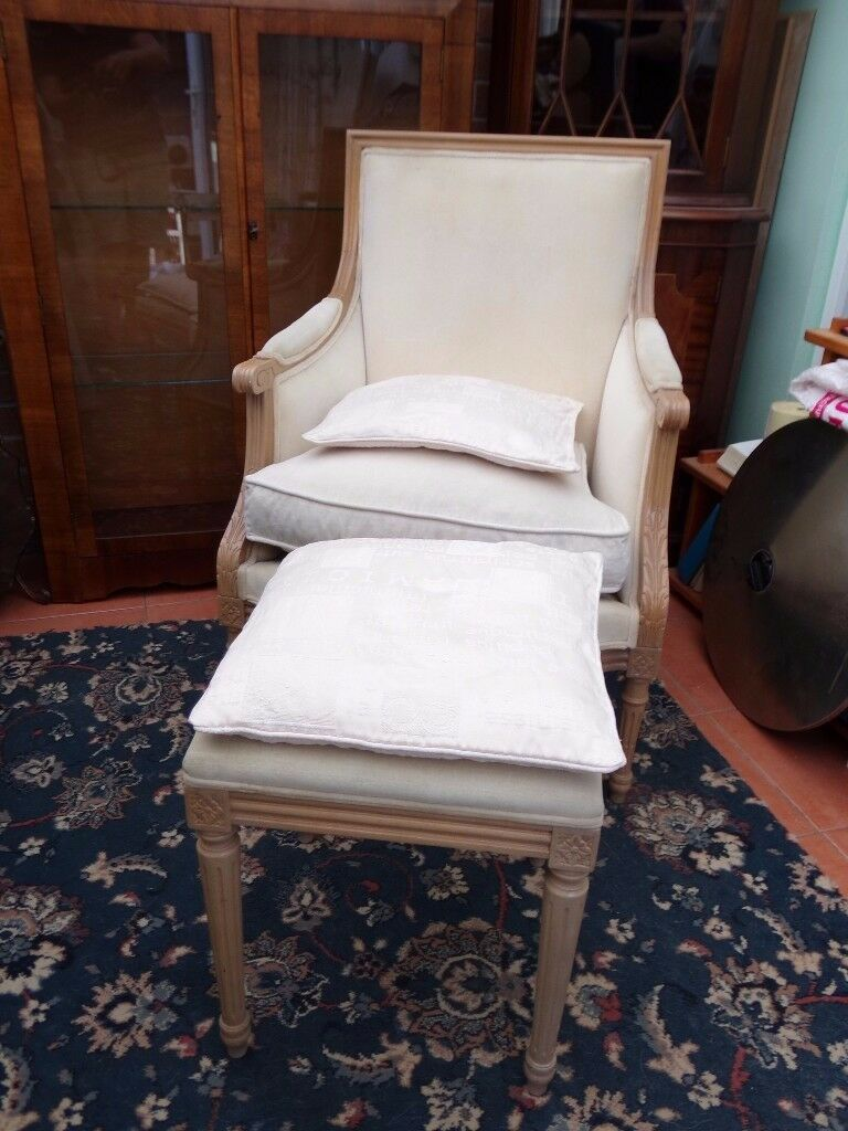 French Louis style armchair and matching footstool with cushions