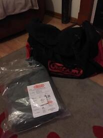 Oregon chainsaw chaps/ leggings new in bag with hold-all