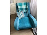 Teal sofa chair and cuddle
