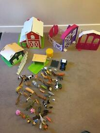 Assorted animal collection with wooden farm houses and plastic stables