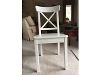 10 high quality, substantial white dining room chairs in mint condition.