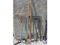 Assorted Garden tools (rake, hoe, weed puller, long handled edging shears, lawn aerator)