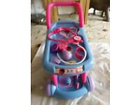Doc Mcstuffins Disney trolley with 8 items in exellent condition