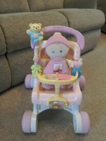 First walker pram and doll