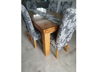 solid chunky oak table with six chairs