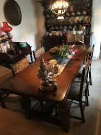 Oak dining table and 6 upholstered Chairs.