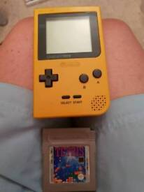 Yellow gameboy pocket and tetris