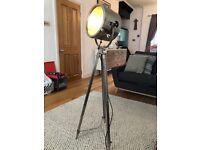 Retro vintage silver spotlight lamp. Floor standing tripod.