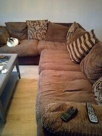 Corner sofa with cushions