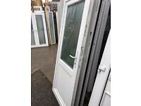 Recycled Upvc Back Door (890 x 2060) £140 -Comes with 1 key. Half Glass / Half Plastic.