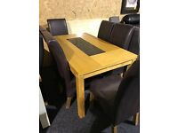 New Modern dining table and six leather chairs--NEW