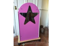 Wooden fancy dress wardrobe and stage background, with clothes