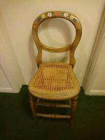 Child's Wooden high stool with pretty painted detail on backrest.
