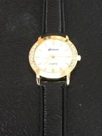 Ladies Geneva watch with quartz movement and a genuine black leather strap