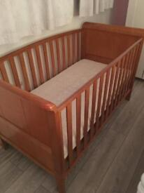 Baby's r us sleigh type cot bed. Comes with mattress. Smoke and pet free home.