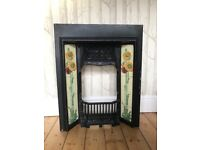 Victorian-style cast iron tiled fireplace with backplate