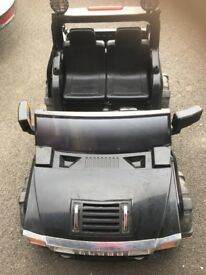 Two seater forceland 12 v black police car.