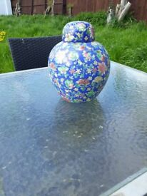 Flowery ceramic pot with lid