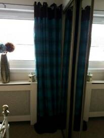 Beautiful teal and brown striped curtains.