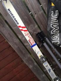 Blizzard 4 quattro thermo skis with Salomon SX SKI Boots