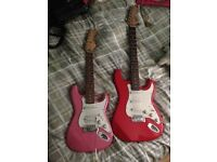Red Electric Guitar, Pink Electric Guitar & amplifier.