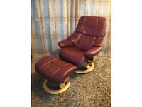 A luxurious medium Reno Ekornes Stressless red armchair and footstool