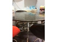 Black/grey speckled round granite/marbled topped table