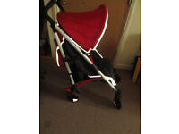 red and black pushchair