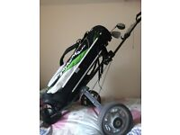 Golf trolley with TaylorMade bag and some well used clubs thrown in.
