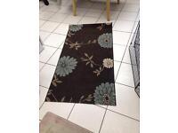 Brown flower rug