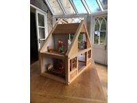Much loved, beautiful 'Plan Toys' Dolls' House with furniture and dolls.