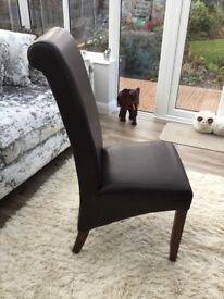 Dark brown leather dining room chairs - set of four hardly used