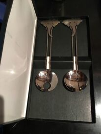 African themed stainless steel salad servers