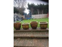 4 large planters 16 inches high by 16 wide
