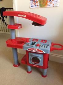 Children's toy kitchen with accessories
