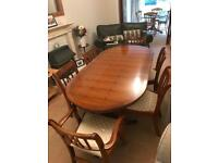 Monagany dining table with 6 chairs (2 with arms)